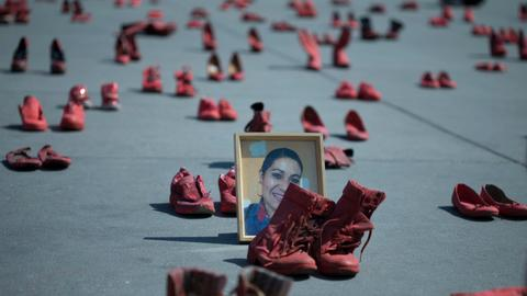 In Mexican capital, red shoes protest killings of women