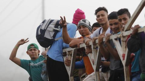 Hundreds of migrants gather in Honduras to form new caravan