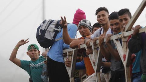 Hundreds of migrants gather in Honduras to form new caravan