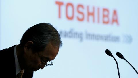 Toshiba reports $8.4 billion loss