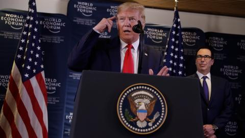 Trump slams 'hoax' impeachment as Senate approves trial rules