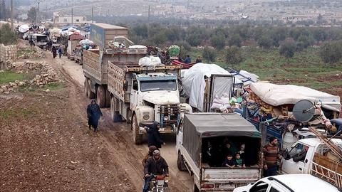 Tens of thousands of civilians flee Idlib as Assad's assault continues