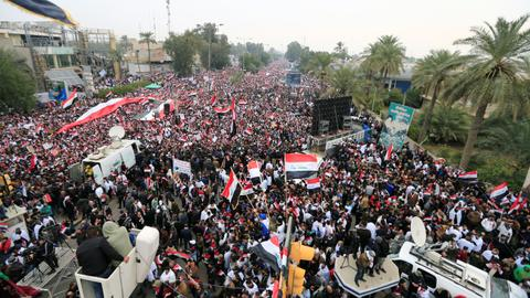 Two Iraqi protesters killed as thousands rally against US military presence