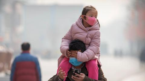 China curbs travel abroad as virus toll tops 100