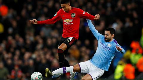 Man City reaches League Cup final despite loss to United