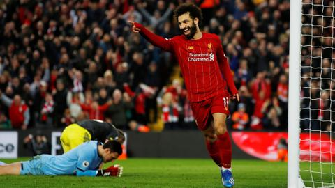 Liverpool go 22 points clear at top, United held on Fernandes debut