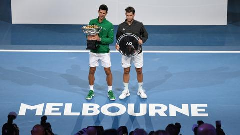 Tennis: Djokovic tops Thiem from brink to win eighth Australian Open