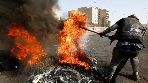Eight killed in Iraq as cleric's followers storm protest camp