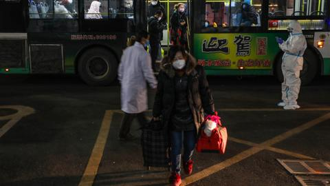 China scrambles to find beds for virus patients as deaths hit 563