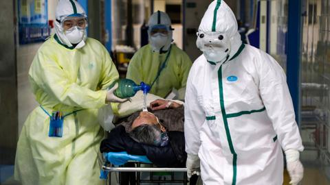 Coronavirus death toll in China surpasses SARS but new cases fall