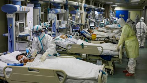 China coronavirus deaths rise past 870, overtaking SARS toll