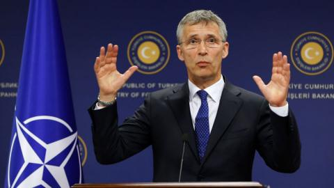 NATO chief praises refugee deal, warns about new routes