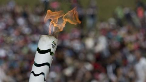 Olympic torch lit in Greek ruins at Olympia
