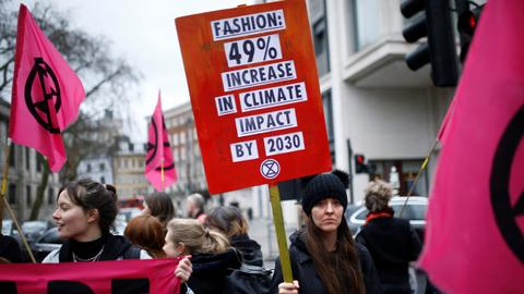 Climate change protest brings flares to London Fashion week