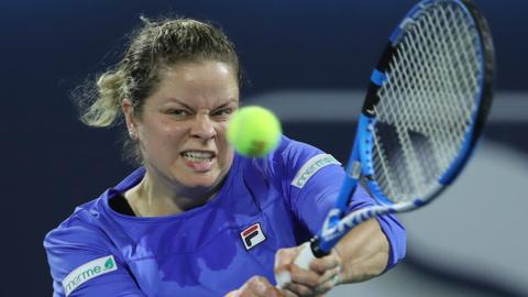 Gritty Clijsters' comeback ended by Muguruza in Dubai