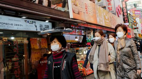 South Korea reports first virus death as 2.5 million urged to stay home