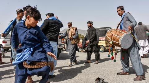 Civilians celebrate as partial truce mostly holds in Afghanistan