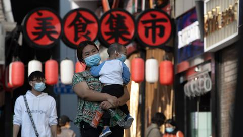 Virus-hit Wuhan cautiously revives amid thicket of controls