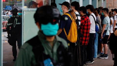 Hong Kong police arrest 300 as thousands protest over security laws