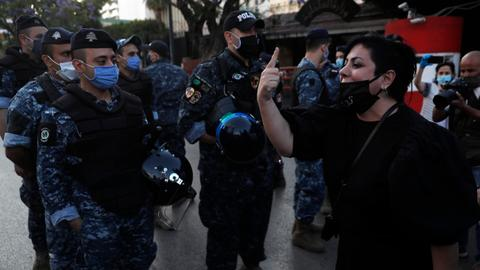 Lebanese riot police face off with protesters