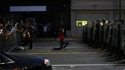 In pictures: violent protests across US over George Floyd's killing