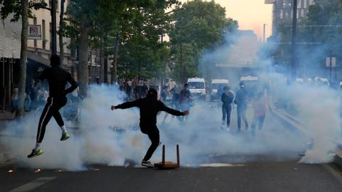 Paris police fire tear gas at anti-racism protesters