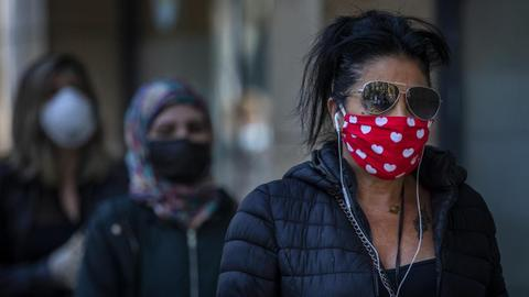 Wear masks in public, says WHO in new coronavirus advice