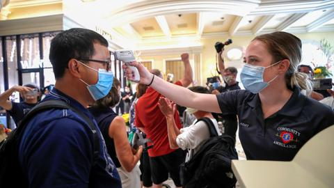 Global coronavirus death toll tops 400,000 – latest updates