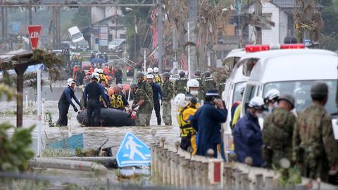 Dozens dead in Japan floods, more rains forecast
