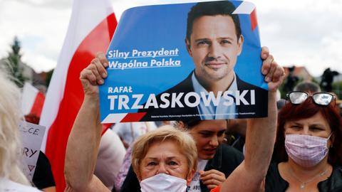 Polish voters head to the ballot box in tight presidential contest