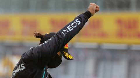 F1 champion Hamilton raises clenched fist in fight against racism