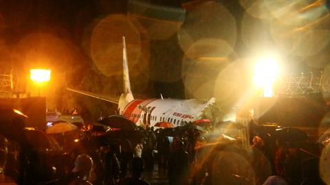 Plane skids off runway and breaks apart in India, killing several