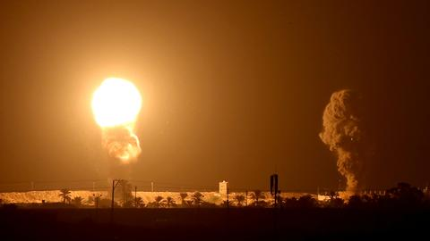 Israel bombs Gaza as Hamas warns of escalation after Arab deals
