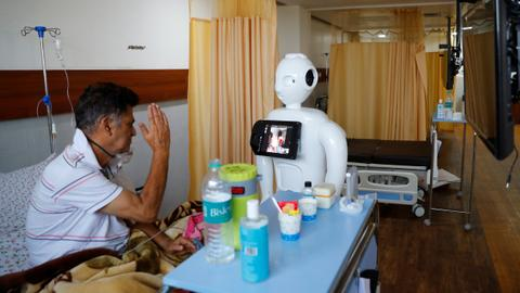 Robot helps India's virus patients speak to loved ones