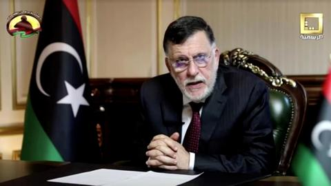 Why is Libya's Prime Minister Fayez al Sarraj stepping down?