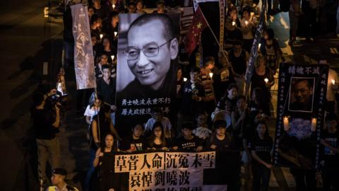 Thousands march in Hong Kong in memory of Liu Xiaobo