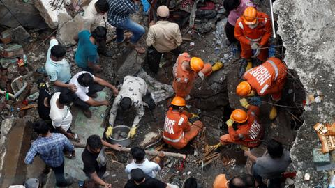 Dozens feared trapped as building due for repairs collapses in India