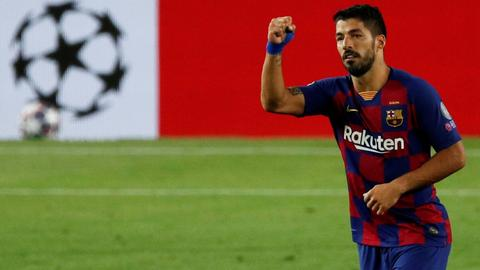 Atletico Madrid signs Luis Suarez from Barcelona