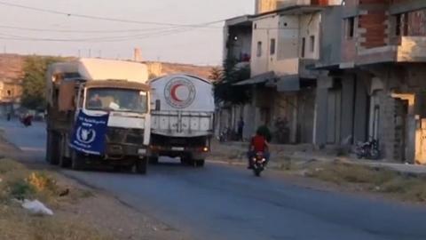 Aid convoy reaches besieged Homs suburb