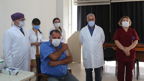 Turkey tests first shot of Covid-19 vaccine on health worker