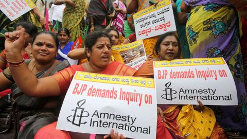 Amnesty suspends India operations after Modi government's 'witch hunt'