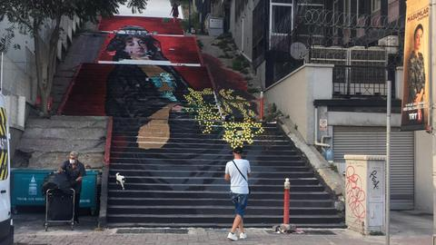 'The Woman with Mimosas' steps out of the museum into the street