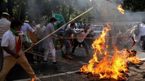 Protesters clash with police in India after rape victim's body cremated