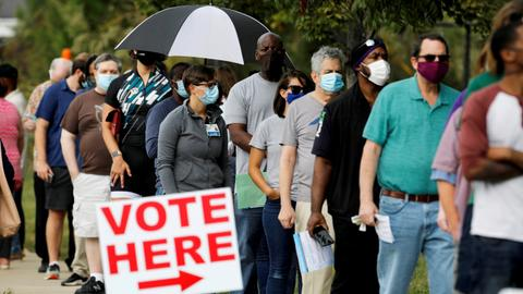 Massive turnout as Americans cast early election votes
