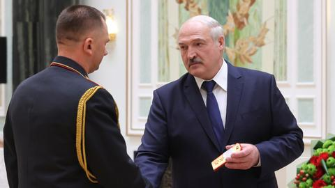 Belarus leader threatens to leave protesters 'without hands'