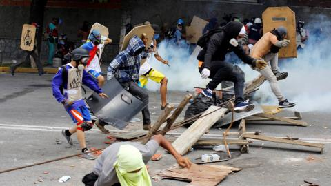 US slaps sanctions on Venezuela's top 13 officials as strike takes off