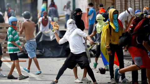 US orders Venezuela embassy families out as crisis deepens