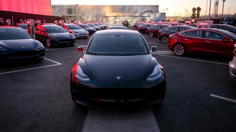 Elon Musk hands over first Model 3 electric cars to buyers