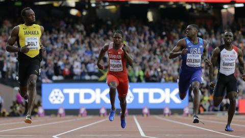 Bolt beaten but through to finals after scoreboard scare