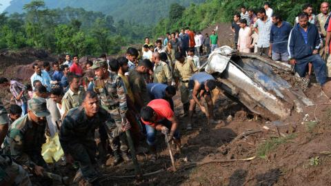 Monsoon floods, landslides kill at least 94 in India and Nepal